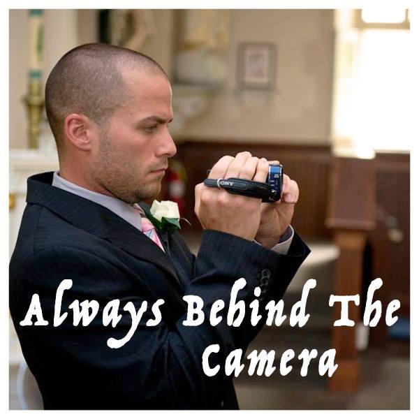 Justin Nolan holding camera, filming wedding
